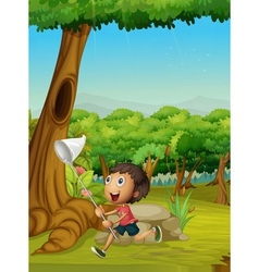 Boy running in a forest vector image