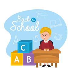 Boy student in the desk with cubes games vector