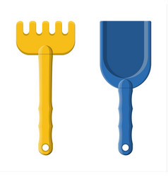 plastic rake and shovel isolated on white vector image