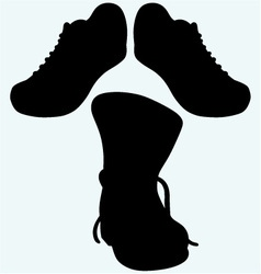 Old dirty boots and sneakers sport shoes vector image vector image