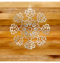 White paper christmas snowflake on a wood EPS8 vector image