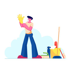 young man put on yellow rubber glove on hand stand vector image