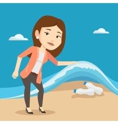 Woman showing plastic bottles under sea wave vector