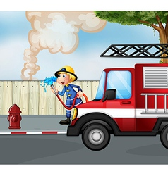 A fireman rescuing a fire near the street vector