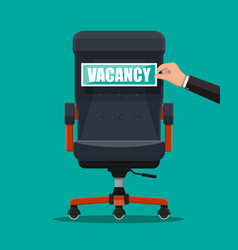 office chair and sign vacancy in hand of boss vector image