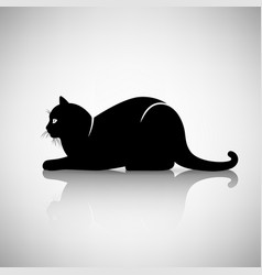 silhouette of a cat lying vector image