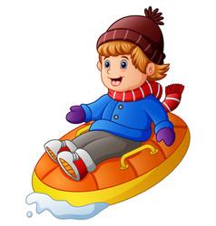 Cartoon happy boy riding an inflatable sled vector