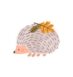 Cute cartoon hedgehog with leaves on needles vector
