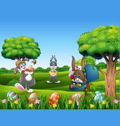 happy easter bunnies holding decorated egg in the vector image