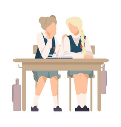 Two girls sitting at school desk and gossiping vector