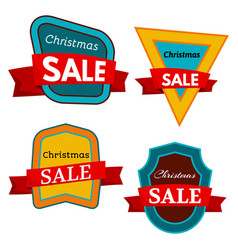 four colorful christmas sale badges vector image