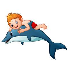 little boy cartoon riding dolphins vector image
