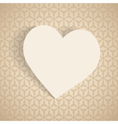 A paper heart on the beige background vector