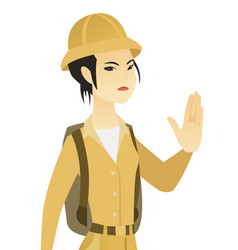 Young asian traveler showing stop hand gesture vector