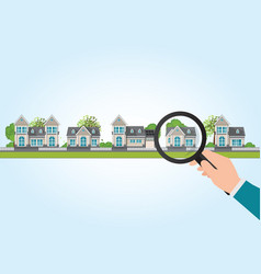 magnifying glass in human hand with house icon vector image vector image