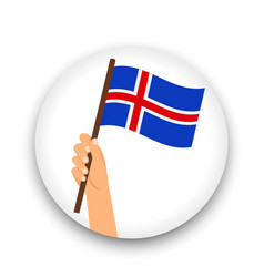 iceland flag in hand round icon vector image