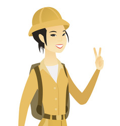 Young asian traveler showing victory gesture vector