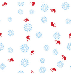 red christmas boot and snowflake seamless pattern vector image