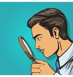 Man looking through magnifier pop art vector image