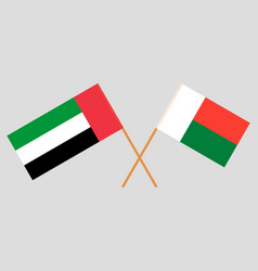 Crossed flags madagascar and united arab vector