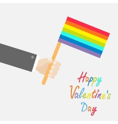 Businessman hand holding rainbow gay pride flag vector image