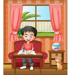 A young boy writing vector image vector image