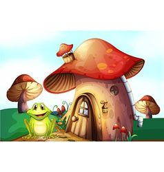 A frog beside a mushroom house vector image