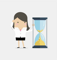 businesswoman is looking at hourglass vector image