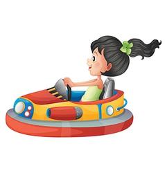 A girl driving the bumpercar vector image vector image