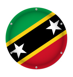 round metallic flag of saint kitts and nevis vector image