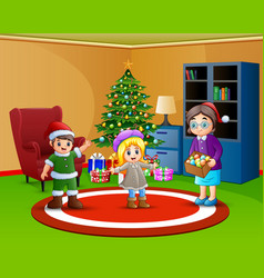 two kids and mother want to decorate a christmas t vector image