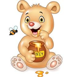 Cartoon funny baby bear holding honey pot isolated vector