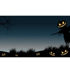 Halloween scarecrow and pumpkins silhouette vector