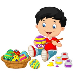 Little boy painting an Easter egg vector