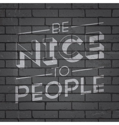 slogan on brickwall be nice to people vector image