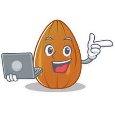 With laptop almond nut character cartoon vector