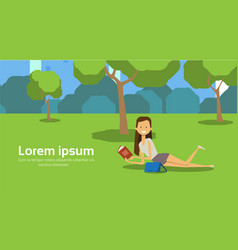 City park woman lies green grass reading book vector