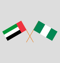 Crossed flags nigeria and united arab vector