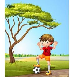 A boy with a soccer ball vector image vector image