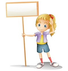 A girl holding an empty signboard vector image vector image