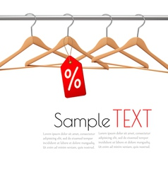 Coat hangers on a clothes rail Discount promotion vector image