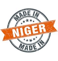 Niger orange grunge ribbon stamp on white vector