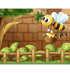 A bee holding a honey inside the fence vector image