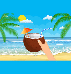 coconut with cold drink alcohol cocktail in hand vector image