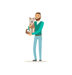Handsome bearded man holding cute dog on hands vector