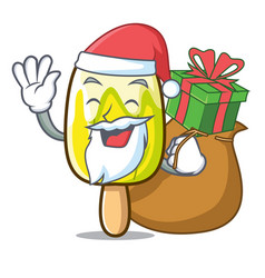 Santa with gift lemon ice cream mascot cartoon vector