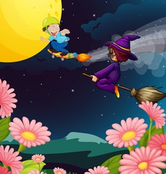 a boy and witch flying vector image