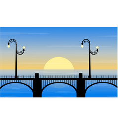 Silhouette of bridge with street lamp at sunset vector