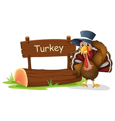a turkey with hat beside signboard vector image