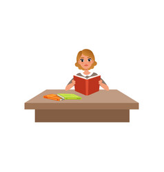 Girl sitting at the desk and reading book student vector